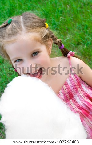 little girl with cotton candy - stock photo
