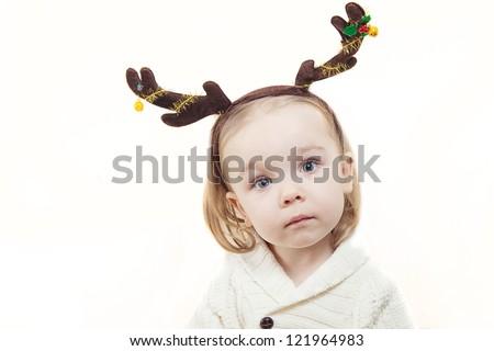little girl with deer costume - stock photo