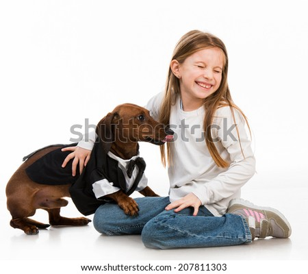 little girl with dolittle girl with a dog breed dachshund isolated on white backgroundg - stock photo