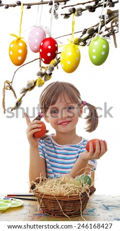 little girl with easter eggs - stock photo