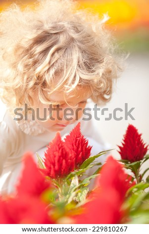 Little Girl with Flower Outdoors shot - stock photo