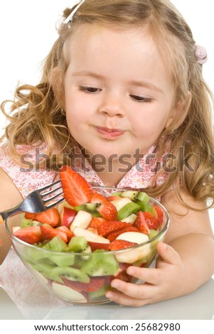 Little girl with fruit salad - closeup, isolated - stock photo