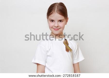 Little girl with George Ribbon (Georgievskaya lenta) - stock photo