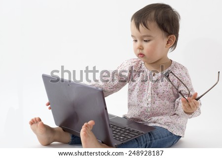 little girl with glasses and digital tablet - stock photo