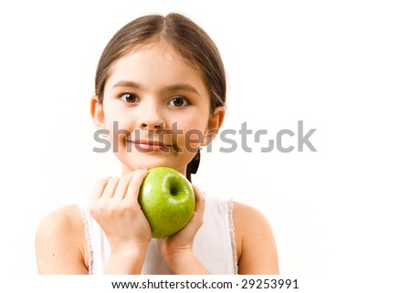 Little girl with green apple - stock photo