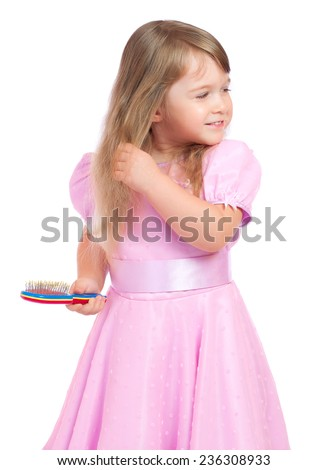Little girl with hair brush - stock photo