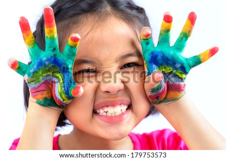 Little girl with hands painted in colorful paint on white background  - stock photo