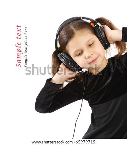 Little girl with headphones - stock photo