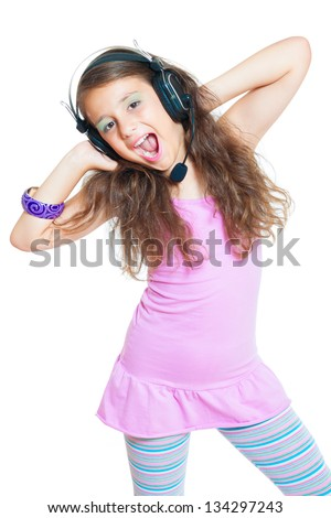 little girl with headphones isolated on white - stock photo