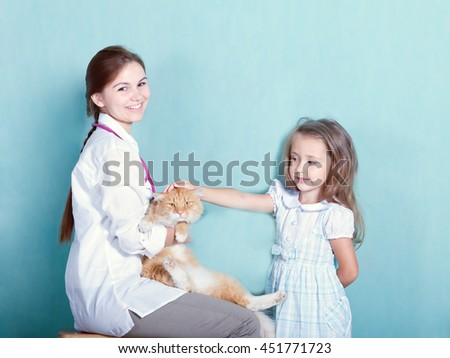 little girl with her cat at the vet.toned  - stock photo