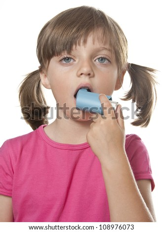 little girl with inhaler - respiratory problems - stock photo
