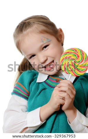 Little girl with lollipop isolated on white - stock photo