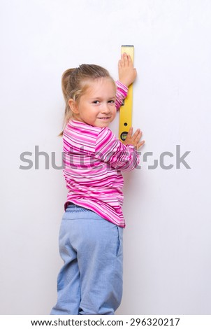 Little girl with measuring level - stock photo