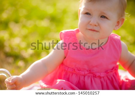 little girl with milk and buns - stock photo