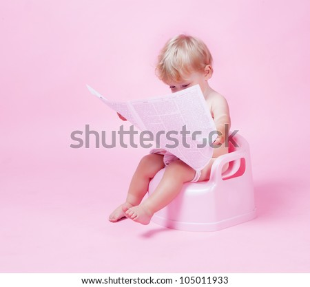Little girl with newspaper on the pot - stock photo