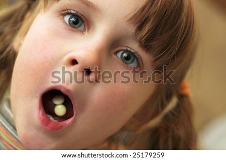 Little girl with opened mouth. - stock photo