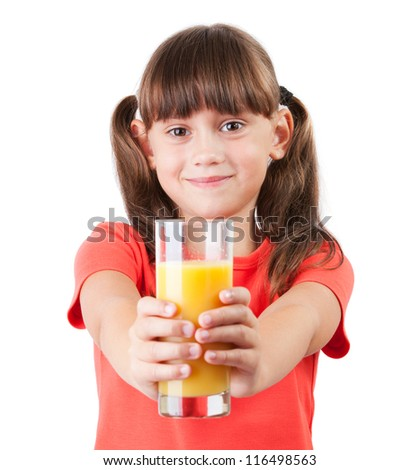 Little girl with orange juice in his outstretched hands - stock photo