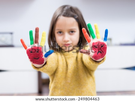 Little girl with painted hand - stock photo