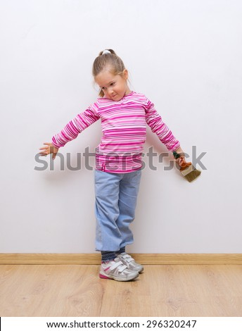 Little girl with painting brush - stock photo