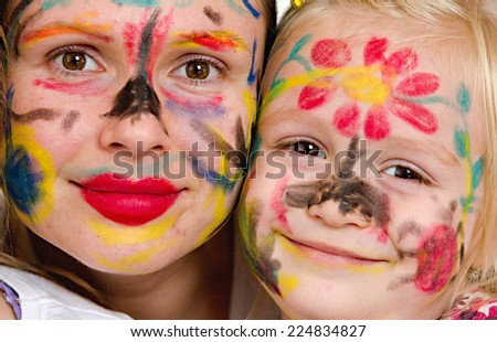 Little girl with painting face as a butterfly - stock photo