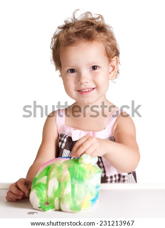 Little girl with piggy bank isolated on white background - stock photo