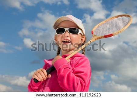 little girl with racket for badminton - stock photo