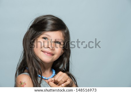 Little girl with real smile - stock photo