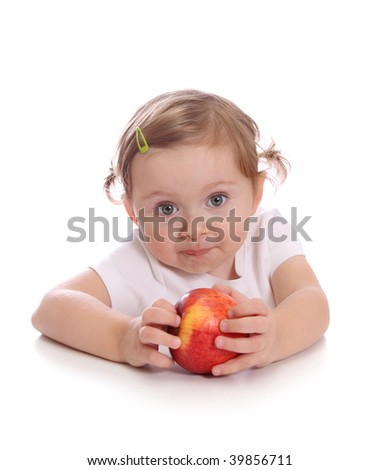 Little girl with red apple isolated on white background - stock photo