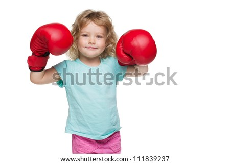 Little girl with red boxing gloves - stock photo