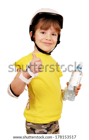 little girl with rolling skater helmet and water bottle - stock photo