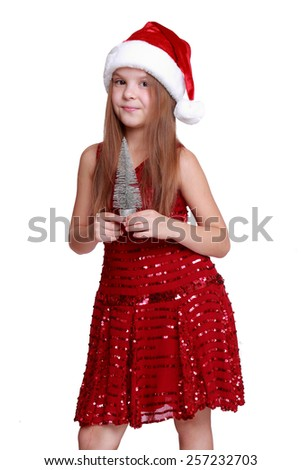 Little girl with small christmas tree dreaming about the holidays - isolated, copy space - stock photo