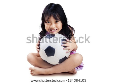 Little girl with soccer ball isolated on white background - stock photo