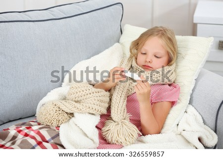 Little girl with sore throat checking temperature - stock photo