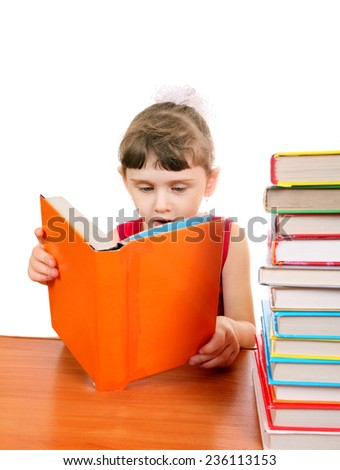 Little Girl with the Books at the Desk on the White Background - stock photo