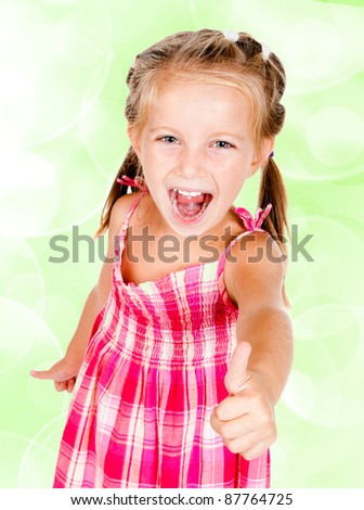 little girl with thumbs up isolated on white - stock photo