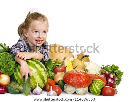 Little girl with vegetable on kitchen. Isolated. - stock photo