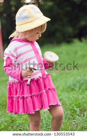 Little girl with white mushrooms - stock photo