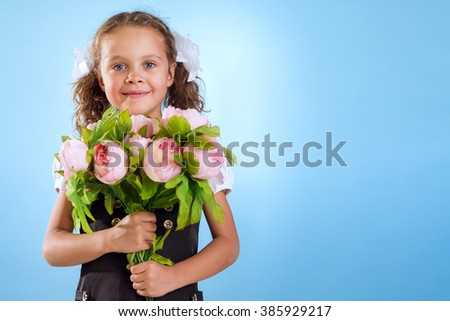 Little Girl Without Teeth Holding A Flowers Isolated On Blue Background - stock photo