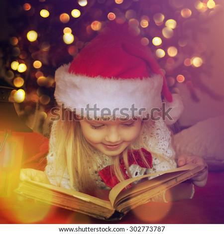 Little girl writes letter to Santa  - stock photo