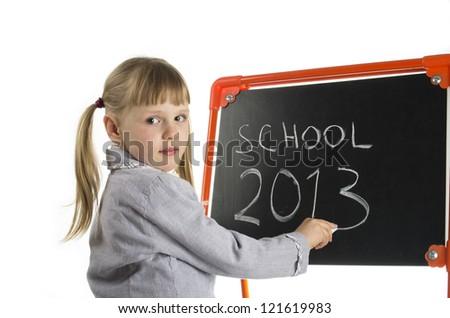 Little girl writing school 2013 at blackboard - stock photo