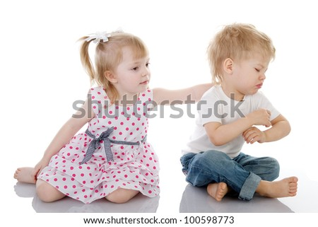 little girls calm the boy. isolated on the white background - stock photo