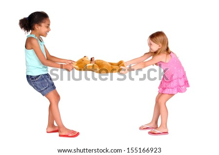 little girls fighting over a toy - stock photo