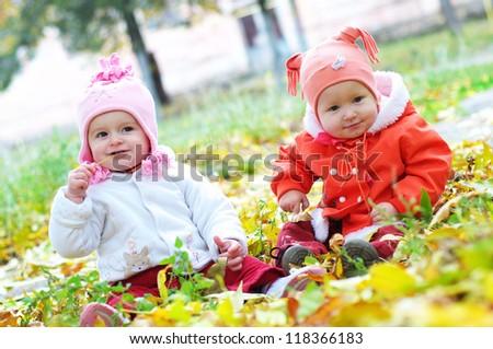 Little girls in the autumn park - stock photo