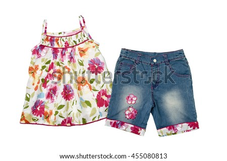 Little girls outfit, colorful summer top and ornate denim shorts - stock photo