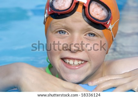 Little girls playing in th blue paddling pool - stock photo