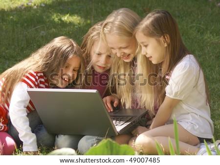 Little girls using laptop - stock photo