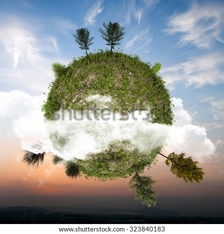 little green planet floating in the sky - stock photo