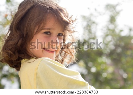 Little haired girl in autumn - stock photo