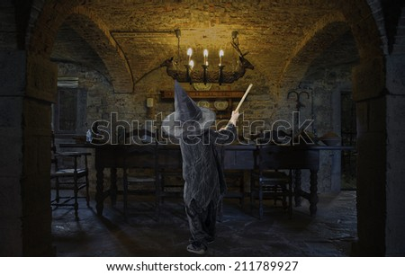 little halloween witch cleaning the dining room - stock photo