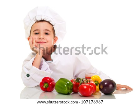 Little happy boy chef in uniform with vegetables lean on hand isolated on white - stock photo
